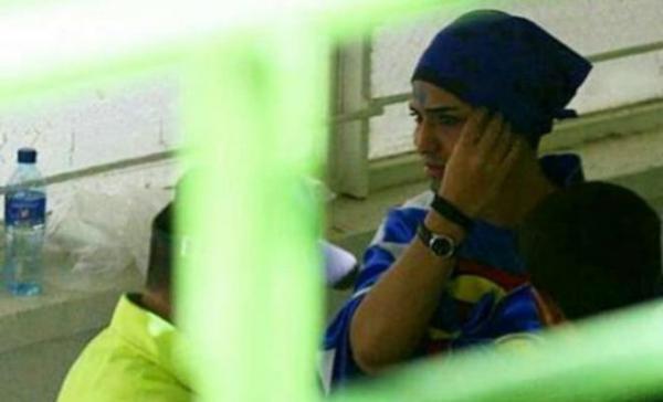 Young Iranian woman disguising herself as a man